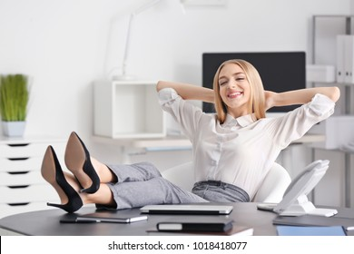 Young businesswoman relaxing in office