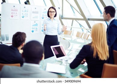 Young businesswoman reporting on business results of the financial period