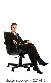 Young businesswoman sat on an office chair