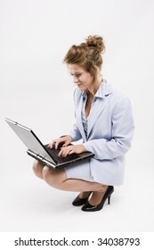 Young businesswoman, secretary or student with laptop, isolated