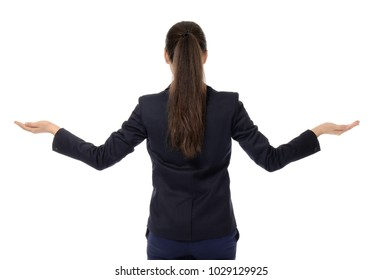 Young businesswoman showing balance gesture on white background