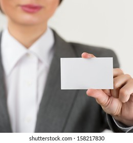 Young businesswoman showing her blank business card