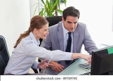 Young businesswoman showing her colleague something on the screen