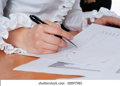 young businesswoman sign important documents