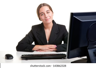 Young Businesswoman sitting at her office desk and smiling, isolated in white