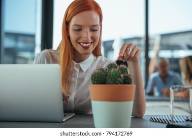 Young businesswoman sitting in an office