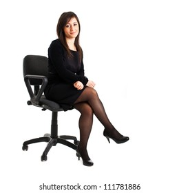 Young businesswoman sitting on a chair isolated on white