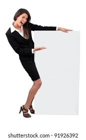 Young businesswoman smiling holding message board