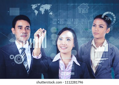 Young businesswoman standing with her partners while drawing growth finance graph on the virtual screen