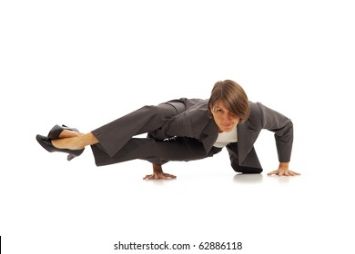 Young businesswoman in suit doing yoga Side Crow Pose
