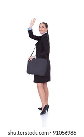 young businesswoman with suitcase on the airport with the plane in the background