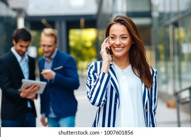 Young businesswoman talking on the phone outdoor