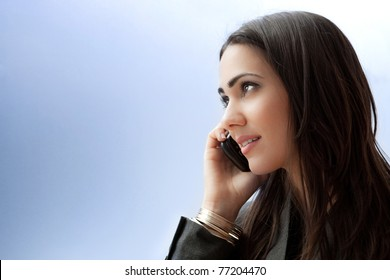 Young businesswoman talking on smart phone