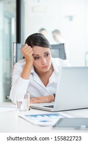 Young Businesswoman unhappy at work, she is think about her problems