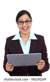 Young businesswoman using tablet computer against white background