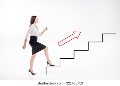Young businesswoman walking up on  steps of the career ladder