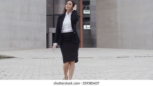 Young businesswoman walking towards the camera