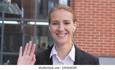 Young Businesswoman Waving Hand Ouside Office