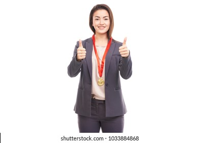 Young businesswoman wearing golden medal on red ribbon