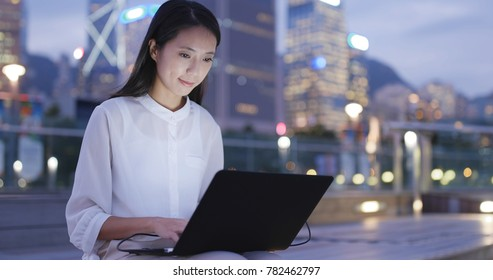 Young Businesswoman work on notebook computer at night