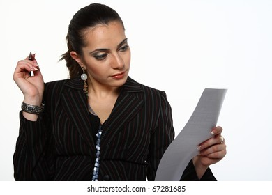 young businesswoman working with document: thinking and looking a paper in her hand