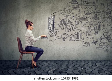 Young businesswoman working in an office brainstorming business plan