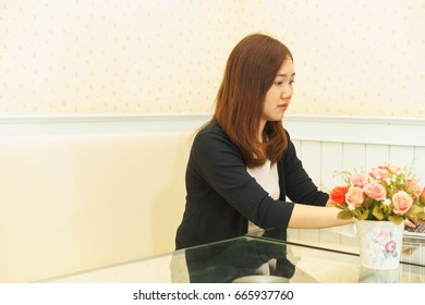Young businesswoman is working on a desk.