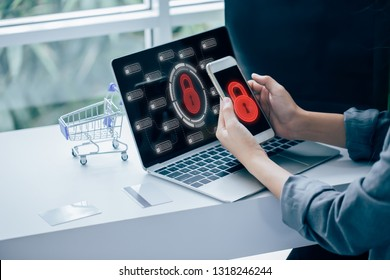 Young businesswoman working on his laptop in the office, select the icon security.Business, technology, internet and networking concept.