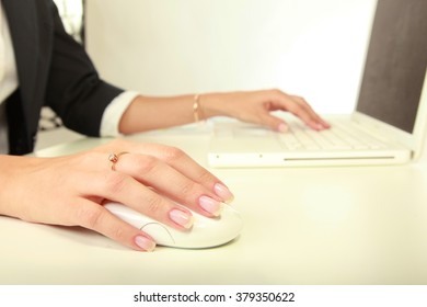 Young businesswoman working on a laptop