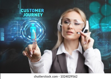 Young businesswoman working in virtual glasses, select the icon customer journey on the virtual display