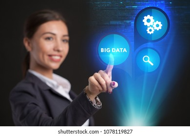 Young businesswoman working in virtual glasses, select the icon big data on the virtual display