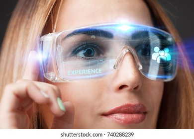 Young businesswoman working in virtual glasses, select the icon experience on the virtual display.