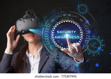 Young businesswoman working in virtual glasses, select the icon Security Awareness on the virtual display