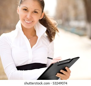 Young Businesswoman writing documents