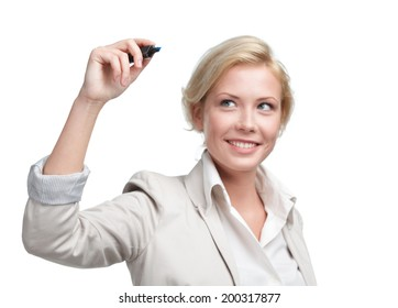 Young businesswoman writing on the invisible screen with marker, isolated on white. Leadership concept