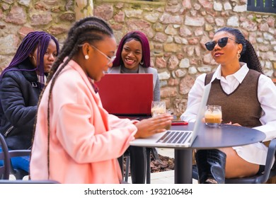 Young businesswomen of black ethnicity. In a business meeting in a cafeteria