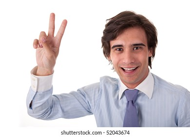 Young bussiness man with arm raised in victory sign, on white background. Studio shot
