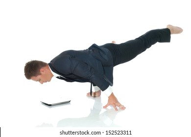 Young busy man posing with laptop in unreal pose