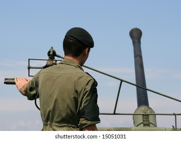 A young cadet in the Canadian military with an old anti-aircraft gun. Ottawa, Ontario, Canada.