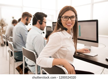 young call center employee works in a modern office