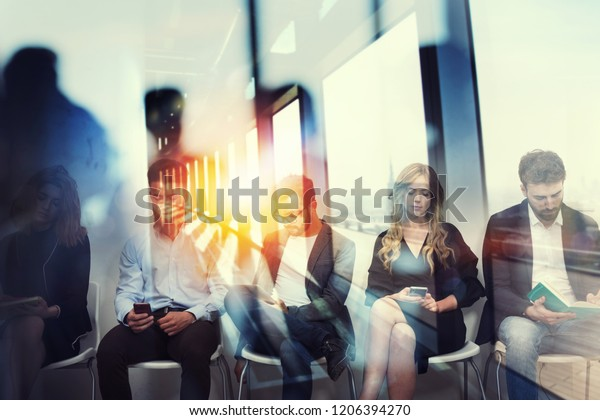 Young candidates waiting for an interview for a job. Concept of recruitment ad career. Double exposure effects with a glass window