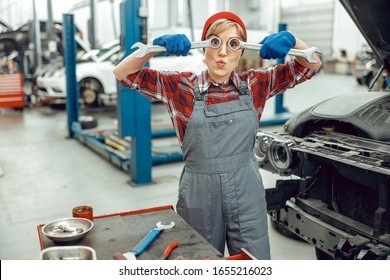 Young car mechanic pulling funny faces in the workplace