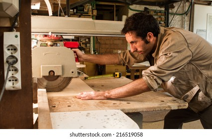 Young carpenter working with a circular saw