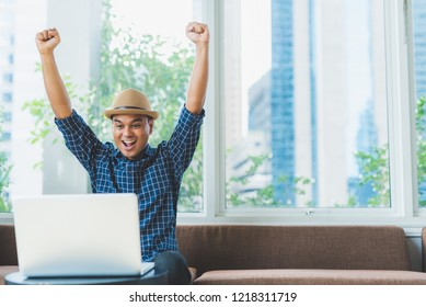 Young casual Asian businessman using laptop computer notebook for work. Planning projects, Shopping online, Startup business, e-learning, lifestyle, education, concept with copy space.