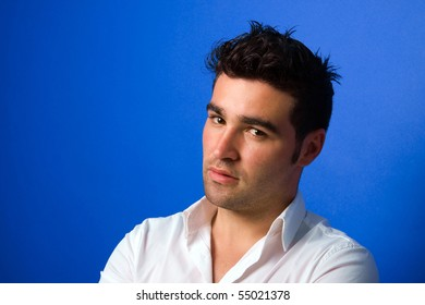 Young casual atractive man portrait, on a blue background