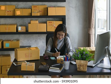 Young casual beautiful women entrepreneur, teenager business owner work at home, many stuff to do today in home. Note new order at papernote.