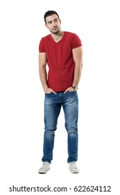 9da45c3eb9c Young casual fashion model with hands in pockets looking away. Full body  length portrait isolated
