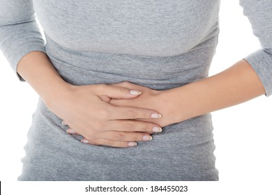 Young casual girl woman is having stomach ache. Over white background.