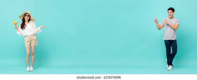 Young casual happy Asian man and woman on light blue long banner background with copy space