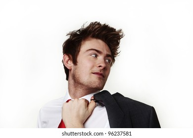young casual looking businessman with his jacket off and over the shoulder